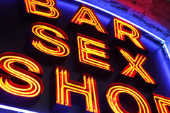 Sex shop. Bar and sex shop neon sign close-up Royalty Free Stock Photo
