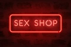 Sex shop neon. Red sign on the wall. Adult store Royalty Free Stock Photo