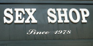 Sex shop sign. In place Pigalle , from1978 Royalty Free Stock Photography