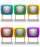 Sex televisioner med antennen Arkivbild