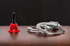 Sex toys, bell and handcuffs Stock Image