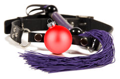 Sex toys. Christmas ball gag and whip, isolated on white background. Close up Royalty Free Stock Photography
