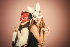 Sex toys. Sex shop. Easter bunny, playboy, friendship. Easter cocept, two pretty girls in rabbit masks Stock Photo