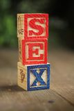 Sex wood blocks. Alphabet wood blocks forming the word sex Royalty Free Stock Photos