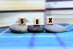 Sex Wort mit drei Buchstaben Stockfotografie