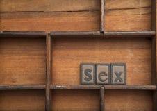 Sexe dans en bois composé Photo libre de droits