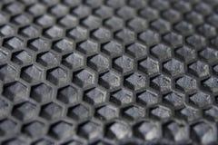 Sexhörningstextur av svart gummi royaltyfri bild