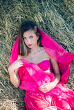 Sexi amazing young lady with long hair in pink Royalty Free Stock Images