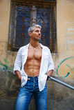 Sexi Man in a white shirt and ornamental window on background. And Dream Catcher Stock Photos