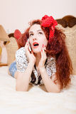 Sexi redhead woman with long hair talking on phone Stock Photography