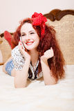 Sexi redhead woman with long hair talking on phone Royalty Free Stock Images