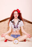 Sexi young redhead woman meditating in lotus pose Stock Images