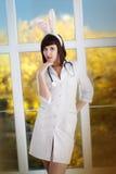 Sexig attraktiv sjuksköterska royaltyfri foto