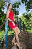 Sexig flicka i rött Fotografering för Bildbyråer