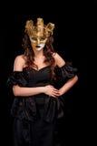 sexig kvinna för guld- maskeringsdeltagare Arkivfoto
