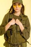 Sexig kvinna i dräkt för soldat` s på gul bakgrund Royaltyfria Foton