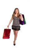 Sexig kvinna med shoping påsar Fotografering för Bildbyråer