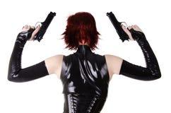 Sexig kvinna med vapen. royaltyfria foton