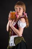 Sexig kvinna Oktoberfest som slickar kanter Royaltyfri Fotografi