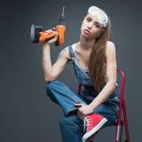 Sexig kvinnlig arbetare arkivfoton