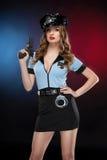 Sexig kvinnlig polis. Arkivbild