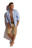 Sexig manlig modell Against White Wall Arkivfoto
