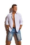 Sexig manlig modellIn Unbuttoned White skjorta Arkivfoto