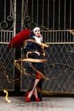 Sexig nunna med röda demonvingar Arkivfoto