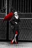 Sexig nunna med röda demonvingar Royaltyfri Fotografi