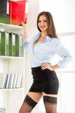 Sexig sekreterare With Binders fotografering för bildbyråer