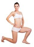 Sexig sportswoman som isoleras på white Arkivfoto