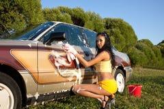 sexig stil för bilflickastift som tvättar sig upp royaltyfri foto