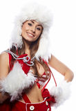 Sexig ung brunettkvinna som kläs som Santa Arkivfoton
