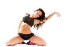Sexig ung yogakvinna som gör yogic övning på isolerad vit Fotografering för Bildbyråer