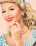 Sexigt blont stift upp kvinna arkivfoto