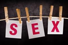 Sexo de la palabra en el papel de notas Fotografía de archivo libre de regalías