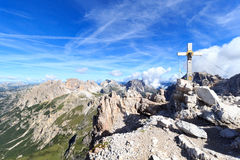 Sexten Dolomites mountain panorama and Paternkofel summit cross in South Tyrol Royalty Free Stock Photo