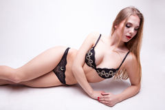 Sexu woman in black lingerie on grey background Stock Photography