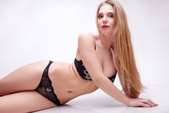 Sexu woman in black lingerie on grey background Stock Photos