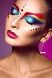 Sexual adult female with closed eyes and multicolor make up Royalty Free Stock Image