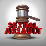 Sexual Assault. Concept and rape crime symbol as a legal court judge mallet hitting a three dimensional text as an icon of sex violence harassment and criminal Stock Photos