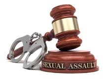 Sexual Assault. Text on sound block and handcuffs Stock Photos