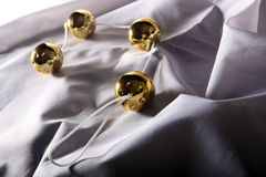 Sexual beads. Four golden sexual beads on a white background stock photography