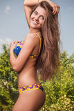Sexual beauty dressed bikini poses in an summer garden. Stock Photography