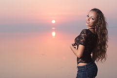 Sexual beauty woman on the beach at sunset Stock Images