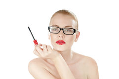 Sexual beauty woman in glasses with mascara brush in hand. Royalty Free Stock Images