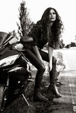 Sexual biker woman wearing black leather jacket with her sport m. Otorcycle on a highway. Beauty, fashion. Adventure and freedom. Black and white photo Stock Image