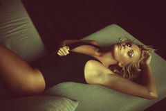 Sexual blond woman lying in bed Royalty Free Stock Images