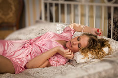Sexual blonde in a boudoir Stock Images