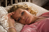 Sexual blonde in a boudoir Stock Photography